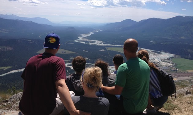 The Sterzer family enjoys a panoramic view of Canal Flats and the Columbia Valley from the top of Mount Sabine.