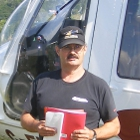 Man in front of a helicopter
