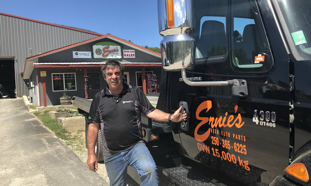 Stuart Ady, the owner/operator of Ernie's Used Auto Parts in Castlegar, B.C., beside his service truck