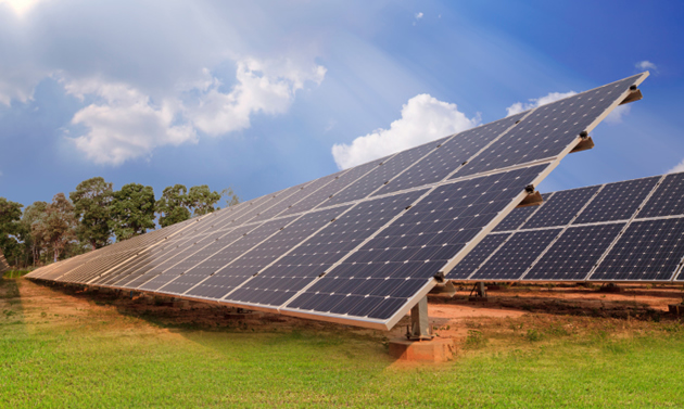 Two large solar panels collect energy beneath a blue sky.
