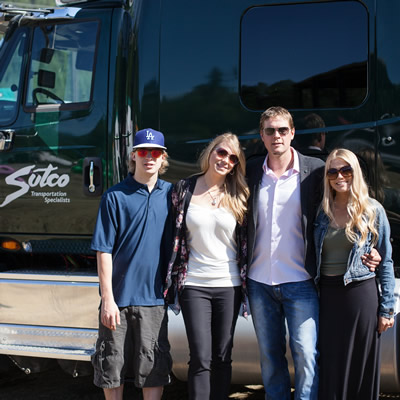 Cole, Melanie, Chris and Courtney Sutherland, with a Sutco truck
