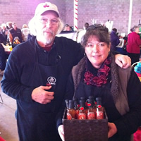 Gary and Susan Snow of Tabletree Juice showcasing their products at the recent Cranbrook Farmer's Market.