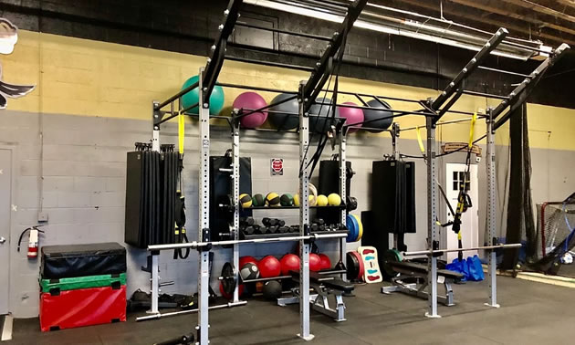 Interior of gym with exercise equipment.