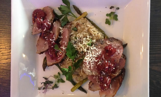 My entree plate shows a duck breast with mushroom risotto, topped with a cherry sauce.