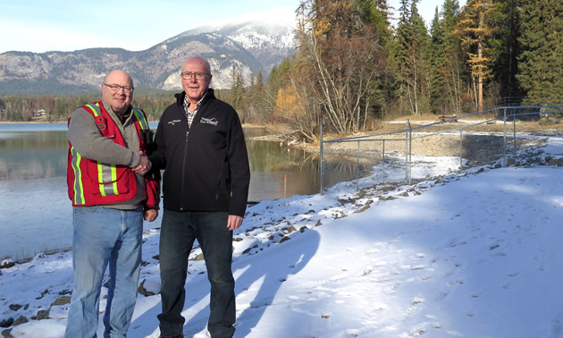 Following a tour of the new dam, RDEK Electoral Area B Director Stan Doehle (right) congratulates project lead Brian De Paoli, RDEK Engineering Technician (left) on the substantial completion of the project.