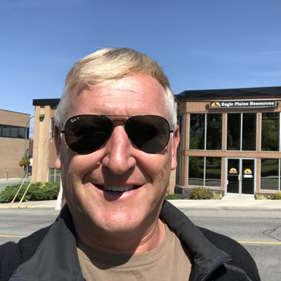 Tim Termuende of Eagle Plains Resources enjoys a sunny moment before heading into his office building