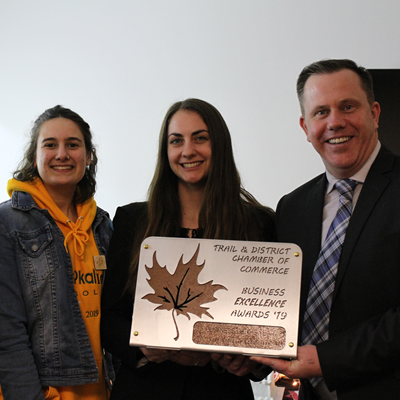 The West Kootenay EcoSociety accepts the award for Business of the Year. Pictured are (L to R) Audry Durham, board member; Alyssa Taburiaux, Trail outreach co-ordinator; Natasha Edmunds, community organizer; and Trail councillor Paul Butler.