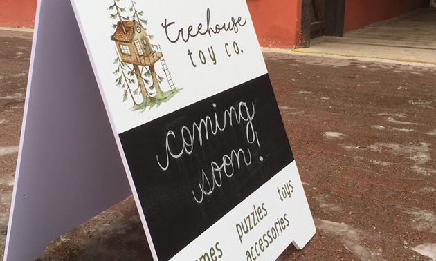 Sandwich board advertising the Treehouse Toy Co.