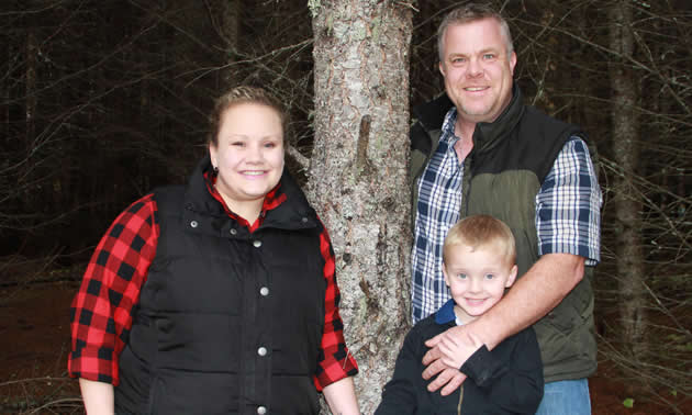 William Trowell, shown here with his wife and son, is the owner of Selkirk Security Services Ltd., in Trail, B.C.