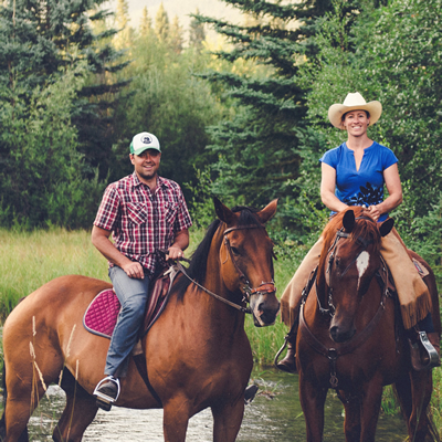 Tyler McNaughton and Sacha Bentall, owners of Cutter Ranch, on horseback on their farm near Fort Steele, B.C.