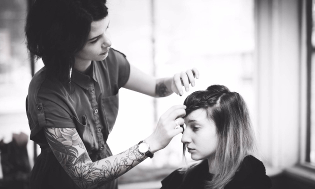 Sara Sansom, owner of Birch & Lace, cutting a customers hair.