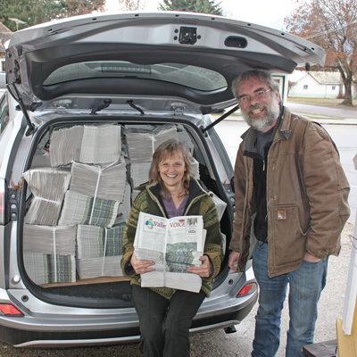The owners of The Valley Voice, Jan McMurray and Dan Nicholson which bundles of newspapers.