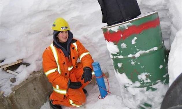 Vanessa Terwoort in orange safety vest, snowy day.