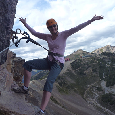 Joanne Sweeting, executive director of Tourism Golden, embraces the Via Ferrata at Kicking Horse Mountain Resort in Golden, B.C.