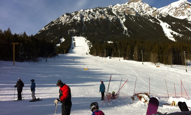 Skiers at the base of a ski run