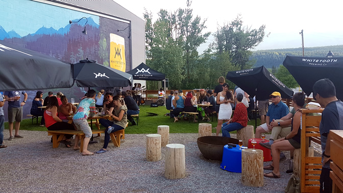 Whitetooth Brewing Co. patio in Golden, B.C., designed by LARCH Landscaping Architecture + Authentic Mountain Design.