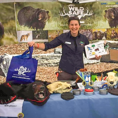 WildSafe BC employee Johanne Lamoureux educates the public at a Bear Smart Community workshop.
