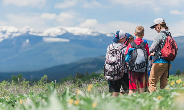 """Kootenay Orchards Elementary students learn to identify grassland wildflowers with Wild Voices """"The Buttes in Bloom"""" program, Spring 2017."""