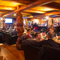 A crowd of diners at Wolf's Den Rustic Mountain Restaurant in Golden, B.C.