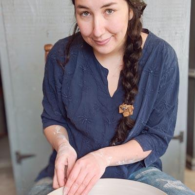 Yuki Kianna Conne creating pottery.