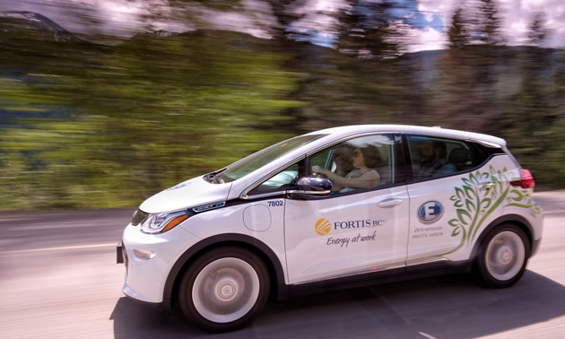 Hon. Michelle Mungall driving the Kootenay Pass in a Chevrolet Bolt, on her way to celebrate the Accelerate Kootenays electric vehicle charging network.
