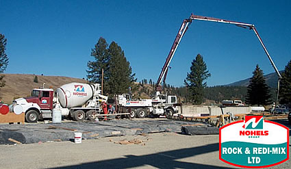 Photo of cement mixing equipment at work