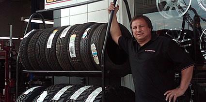 Joe Fritz, standing in his store