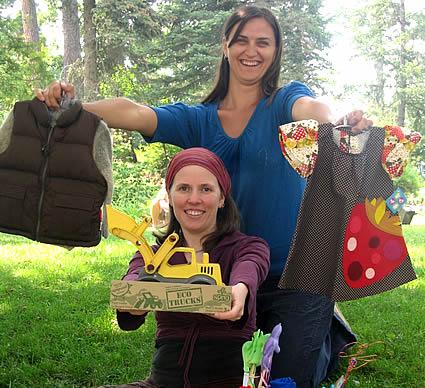 Two women holding children's toys