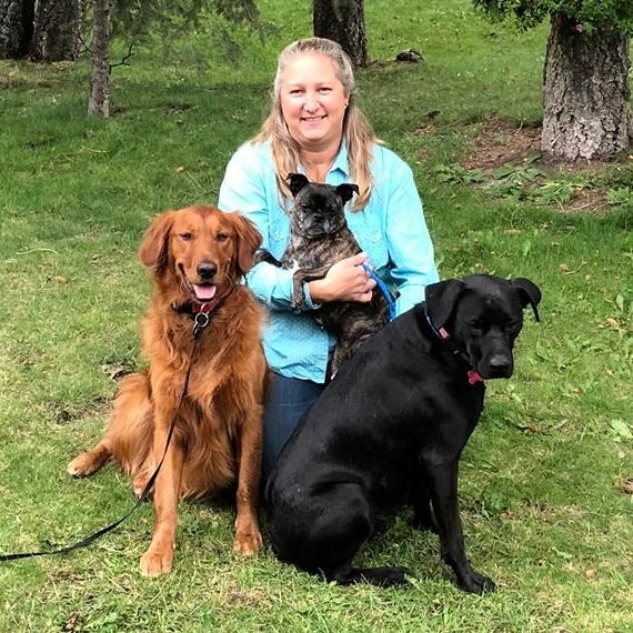 three dogs and a lady - owner of unleashed, Amber Schick