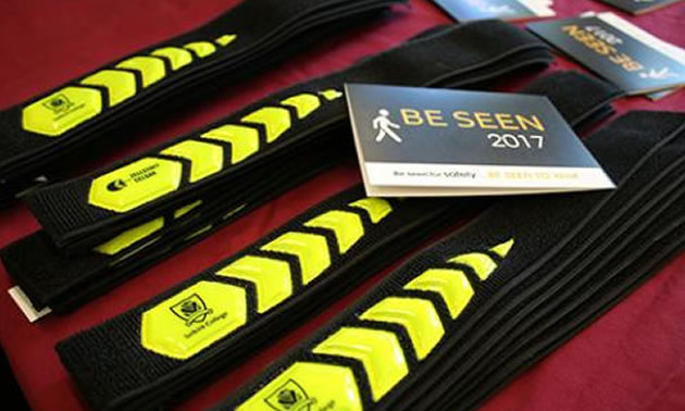 The BE SEEN armbands that are being handed include some that are Selkirk College branded.