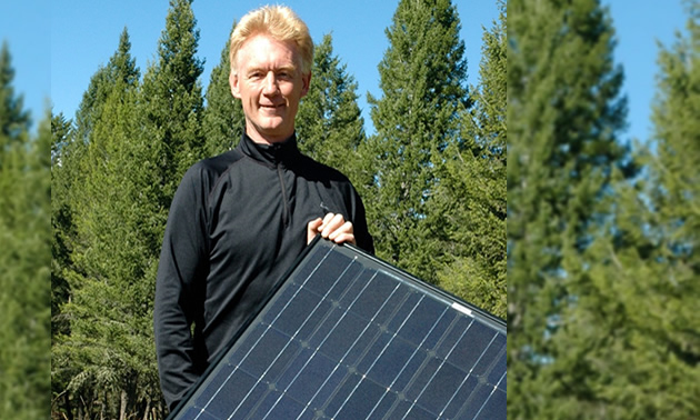 Bill Swan holding a solar panel