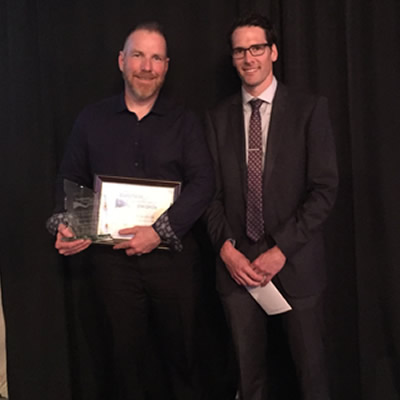 Steve Mercandelli (left), sales manager at Cranbrook Dodge is congratulated on being Cranbrook's Business Person of the Year by Brent Jossy of Scotia Bank and a representative of the Bankers Association of Cranbrook.