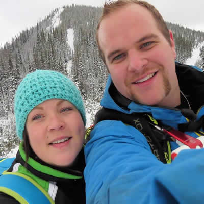 A young man and woman in the backcountry.