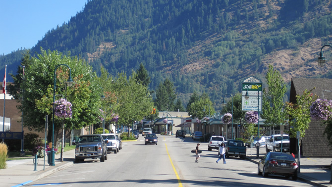 Castlegar's downtown street with deciduous trees lining it