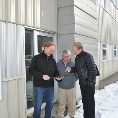 (From left) Local entrepreneur Brian Fry discusses his plan for an innovation centre with Columbia Basin Trust's Tim O'Doherty, Senior Manager, Investments, and Jon Exley, Manager, Assessment and Development.