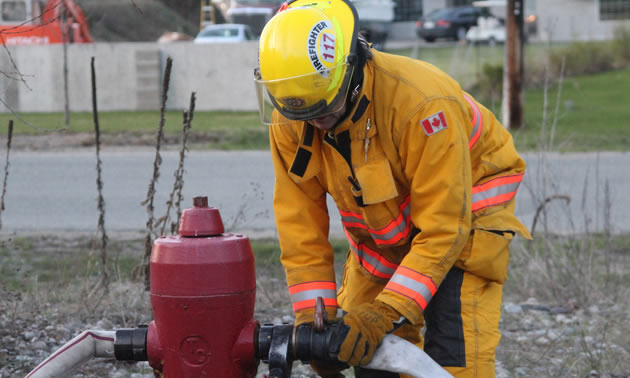 Christina Lake Fire and Rescue crew tap a hydrant.