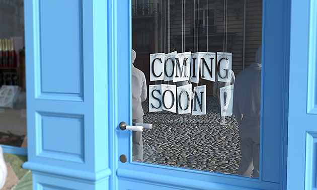 Coming Soon sign on blue door.
