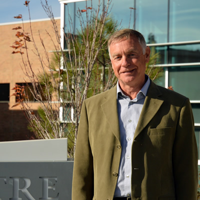 David Walls, president and CEO of College of the Rockies stands in front of the main campus in Cranbrook.