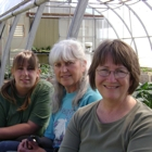 Photo of Kristy Pelletier, Anita Sawyer and Karen Powis in front of a greenhouse