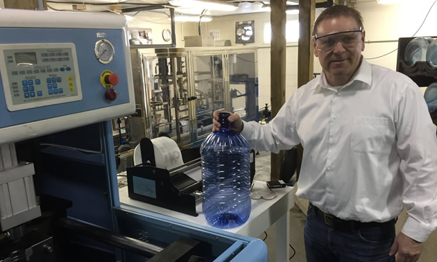 Owner Murray Floyd demonstrates Culligan new bottling facility and announces major expansion of his companies.