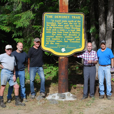 Picture of the Dewdney Trail Heritage Society members with a newly restored sign.