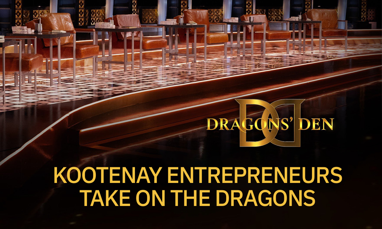 Dragons' Den stage with logo.