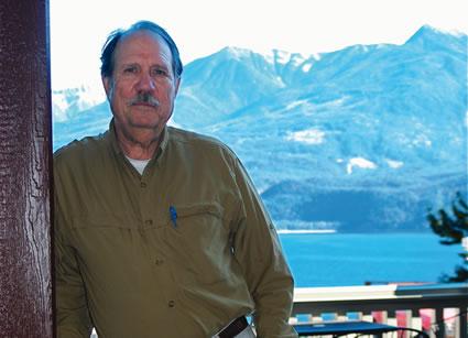Photo of John Eckland on a balcony
