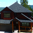 Two-storey, wood-faced house in a new subdivision in an alpine setting.