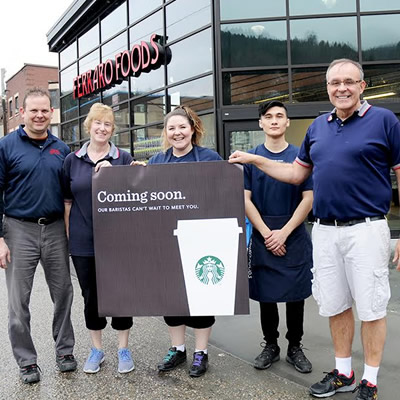 Pictured in this photo (L to R): Ferraro Foods's Jodi Bradford; Karen Parkinson; Carolyn Whitley (Starbucks manager); Matthew Newton and Danny Ferraro as they excitedly announced the new Starbucks to the local Trail Times newspaper.