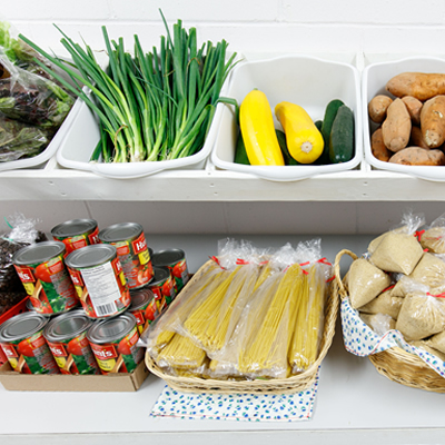 Picture of containers of food in a row - broccoli, dry spaghetti, tomato sauce, potatoes, eggs.