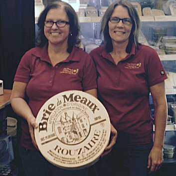 Joy Guyot (L) and Michelle Nagy-Deak are co-owners of The French Connection Cheese Club in Golden, B.C. The shop can be found in an unusual location—the city's municipal campground. Photo credit: Photo courtesy The French Connection Cheese Club