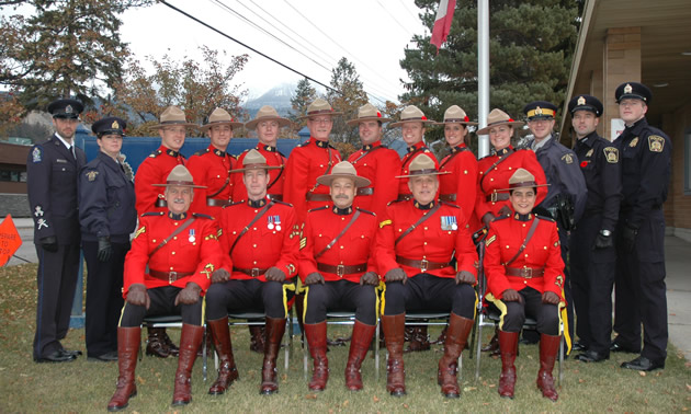 a group of RCMP posing wearing their red serge uniforms