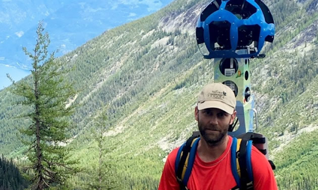 Picture of hiker with Google Trekker camera.