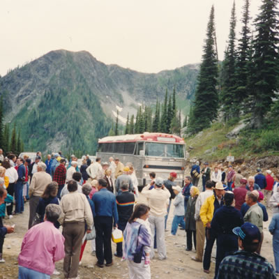 Large group of people in front of a bus